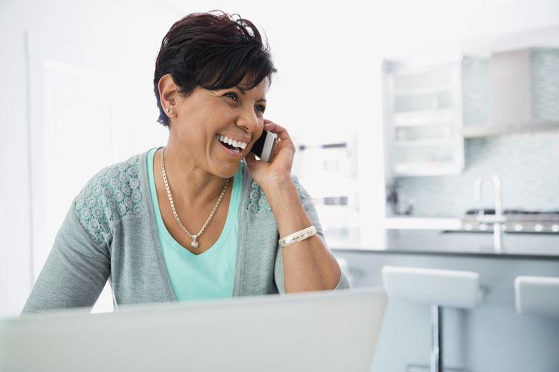 Smiling woman enjoying her local voice service using Ponderosa GO